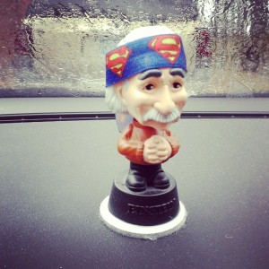 It's a bobble head that I have sitting on the dash of my car. The headband, around his head, is a Superman bracelet that belongs to my daughter.